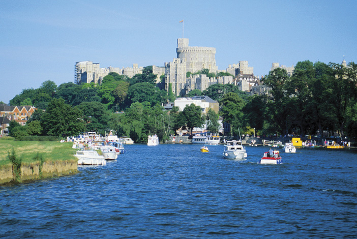Rivers - The Image shows boats on the River Thames outside Windsor Castle, England UK
